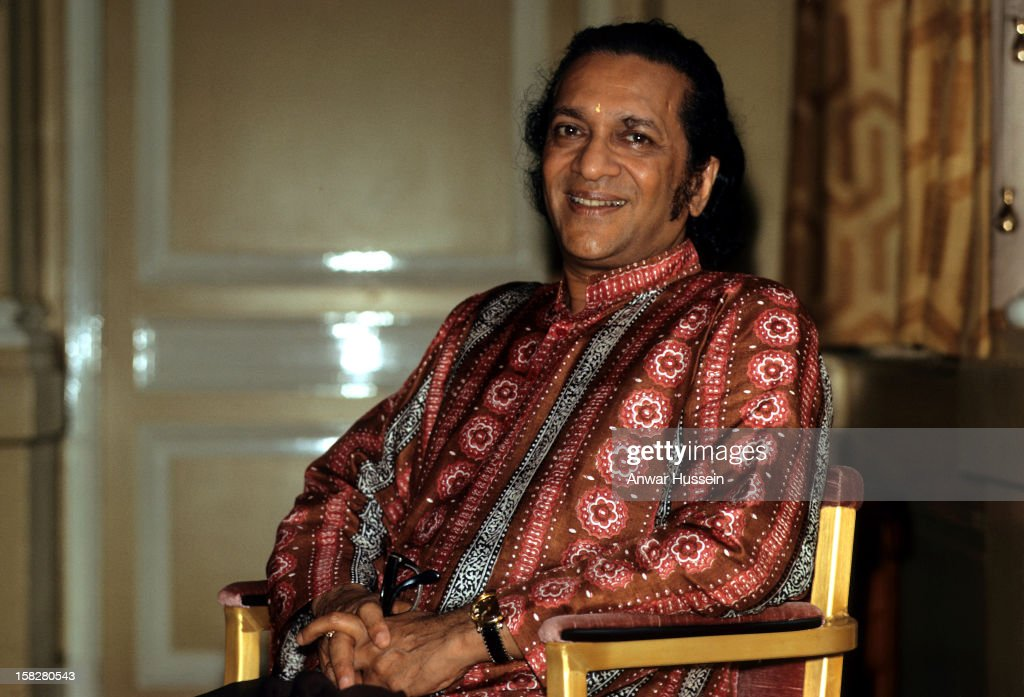 Ravi Shankar relaxes in the Savoy Hotel during a visit to London in August 1974 in London, England.