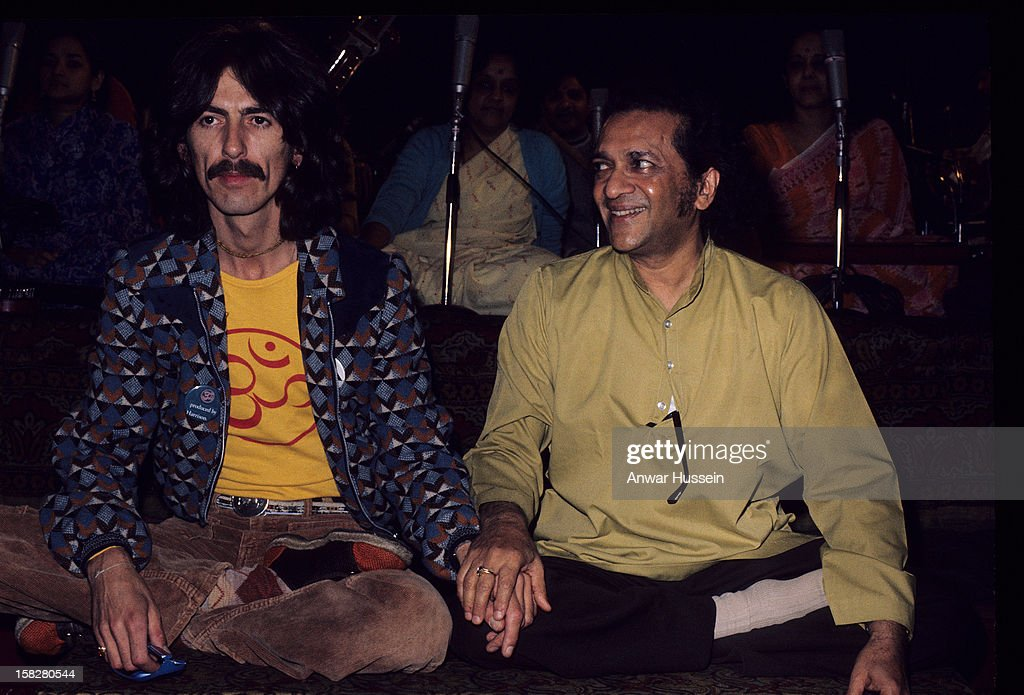 Ravi Shankar sits with Beatle <a gi-track='captionPersonalityLinkClicked' href=/galleries/search?phrase=George+Harrison&family=editorial&specificpeople=90945 ng-click='$event.stopPropagation()'>George Harrison</a> in London, England, circa 1970.