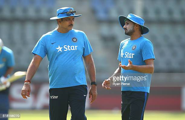 Ravi Shastri Head Coach of India speaks with Harbhajan Singh of India during an India training session at Wankhede Stadium on March 30 2016 in Mumbai...