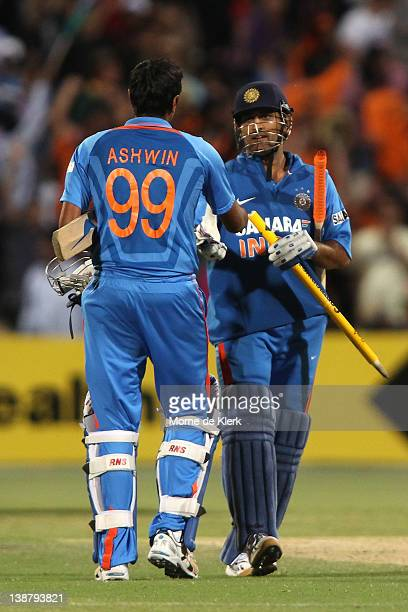 Ravichandran Ashwin and MS Dhoni celebrate hitting the winning runs during game four of the One Day International Series between Australia and India...
