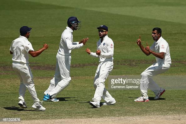 Ravichandran Ashwin of India and capatin Virat Kohli of India celebrate after dismissing David Warner of Australia during day four of the Fourth Test...