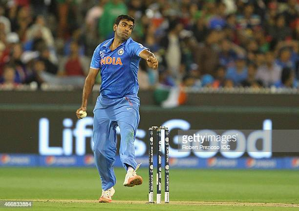 Ravichandran Ashwin of India bowls during the 2015 ICC Cricket World Cup match between India and Bangladesh at Melbourne Cricket Ground on March 19...