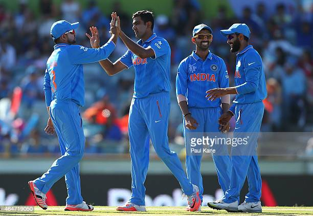 Ravichandran Ashwin of India celebrate sthe wicket of Mohammad Naveed of the UAE during the 2015 ICC Cricket World Cup match between India and the...