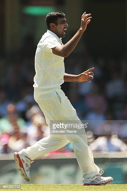 Ravichandran Ashwin of India celebrates after claiming the wicket of David Warner of Australia during day four of the Fourth Test match between...