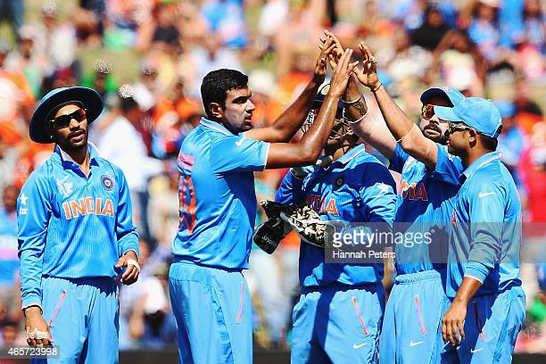 Ravichandran Ashwin of India celebrates after dismissing Paul Stirling of Ireland during the 2015 ICC Cricket World Cup match between Ireland and...