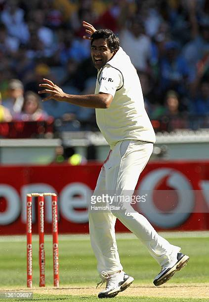 Ravichandran Ashwin of India celebrates after taking the wicket of Ed Cowan of Australia during day one of the First Test match between Australia and...