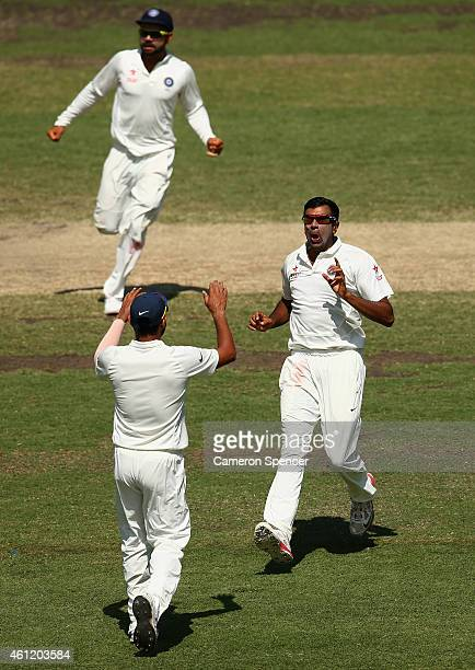 Ravichandran Ashwin of India celebrates dismissing Shane Watson of Australia during day four of the Fourth Test match between Australia and India at...