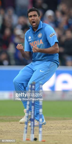 Ravichandran Ashwin of India celebrates the dismissal of England batsman Jonathan Trott during the reducedovers ICC Champions Trophy Final between...