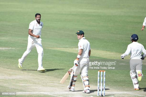 Ravichandran Ashwin of India celebrates the wicket of Glenn Maxwell of Australia during the 3rd day of their fourth test cricket match against...