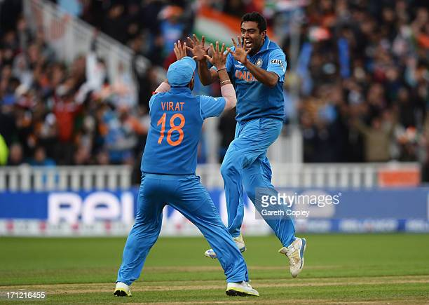 Ravichandran Ashwin of India celebrates the wicket of Joe Root of England with Virat Kohli during the ICC Champions Trophy Final between England and...