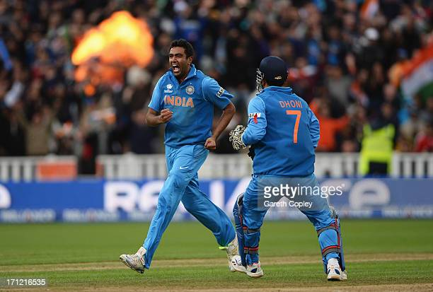 Ravichandran Ashwin of India celebrates the wicket of Joe Root of England with Mahendra Singh Dhoni during the ICC Champions Trophy Final between...