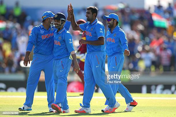 Ravichandran Ashwin of India celebrates the wicket of Jonathan Carter of the West Indies during the 2015 ICC Cricket World Cup match between India...