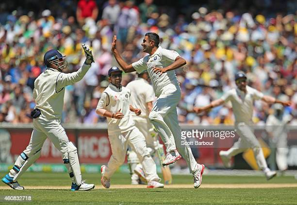 Ravichandran Ashwin of India celebrates with MS Dhoni and his teammates after dismissing Shane Watson of Australia during day one of the Third Test...