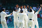Ravichandran Ashwin of India celebrates with team mates after taking the wicket of Shane Watson of Australia during day four of the Fourth Test match...