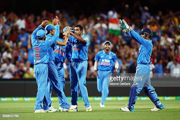 Ravichandran Ashwin of India celebrates with teammates after taking the wicket of Shane Watson of Australia during game one of the Twenty20...