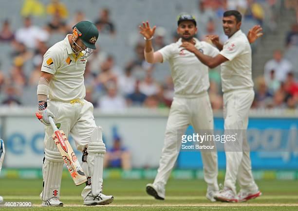 Ravichandran Ashwin of India celebrates with Virat Kohli after dismissing David Warner of Australia during day four of the Third Test match between...
