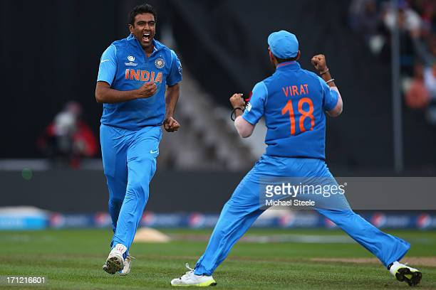 Ravichandran Ashwin of India celebrates with Virat Kohli after taking the wicket of Joe during the ICC Champions Trophy Final match between England...