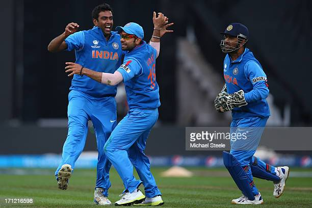 Ravichandran Ashwin of India celebrates with Virat Kohli and MS Dhoni after taking the wicket of Joe during the ICC Champions Trophy Final match...