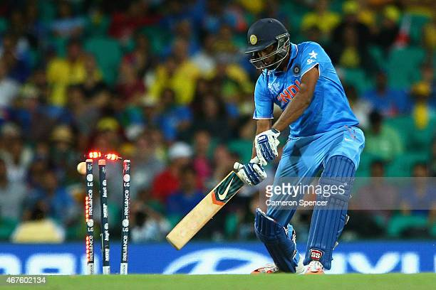 Ravichandran Ashwin of India is bowled by James Faulkner of Australia during the 2015 Cricket World Cup Semi Final match between Australia and India...