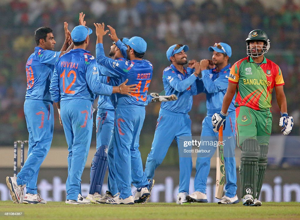 Ravichandran Ashwin of India is congratulated by his teammates after dismissing Tamim Iqbal of Bangladesh during the ICC World Twenty20 Bangladesh 2014 match between Bangladesh and India at Sher-e-Bangla Mirpur Stadium on March 28, 2014 in Dhaka, Bangladesh.