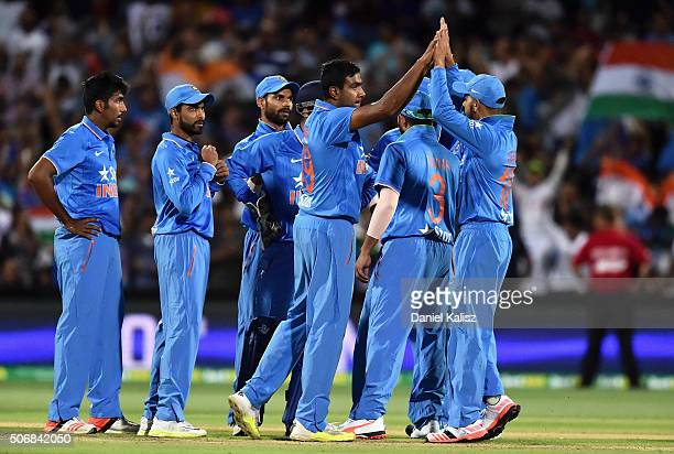 Ravichandran Ashwin of India reacts after taking the wicket of Shane Watson of Australia during game one of the Twenty20 International match between...