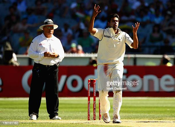 Ravichandran Ashwin of India watches as Rahul Dravid drops a chance off his bowling during day three of the First Test match between Australia and...