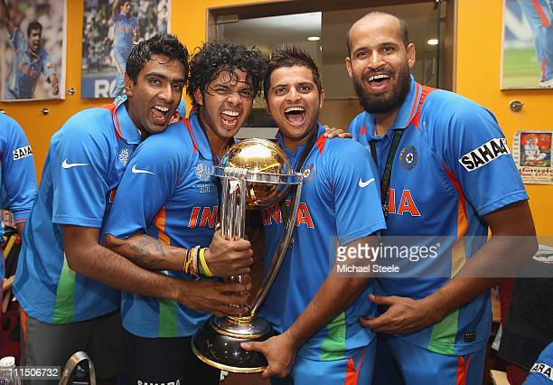 Ravichandran Ashwin Shanthakumaran Sreesanth Suresh Raina and Yusuf Pathan pose with the world cup trophy in the players dressing room after their...