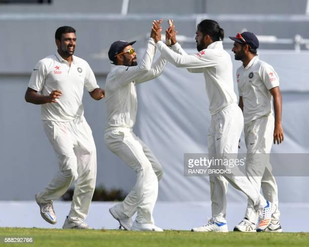 Ravichandran Ashwin Virat Kohli Ishant Sharma and Bhuvneshwar Kumar of India celebrate the dismissal of Leon Johnson of West Indies during day 2 of...