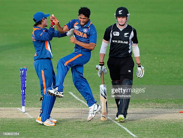 Ravikant Singh and Smit Patel of India celebrates the dismissal of Connor Neynens of New Zealand during the ICC U19 Cricket World Cup 2012 Semi Final...