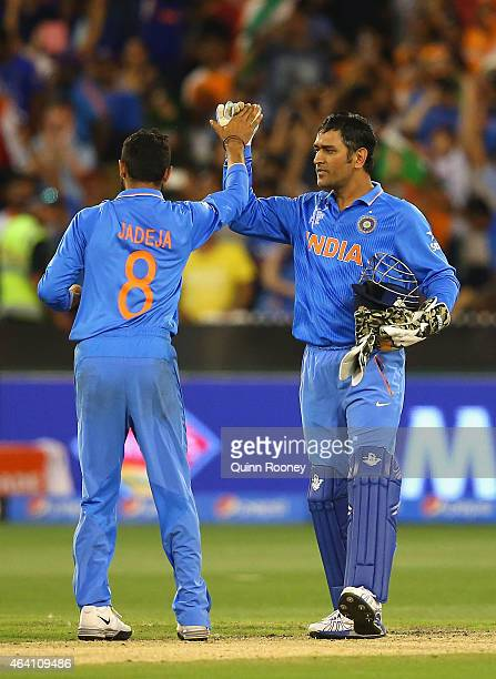 Ravindra Jadeja and MS Dhoni of India celebrate winning the 2015 ICC Cricket World Cup match between South Africa and India at Melbourne Cricket...