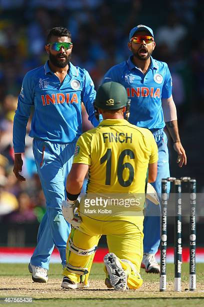 Ravindra Jadeja and Virat Kohli of India appeal to their captain MS Dhon to call for the DRS after an LBW shout against Aaron Finch of Australia was...