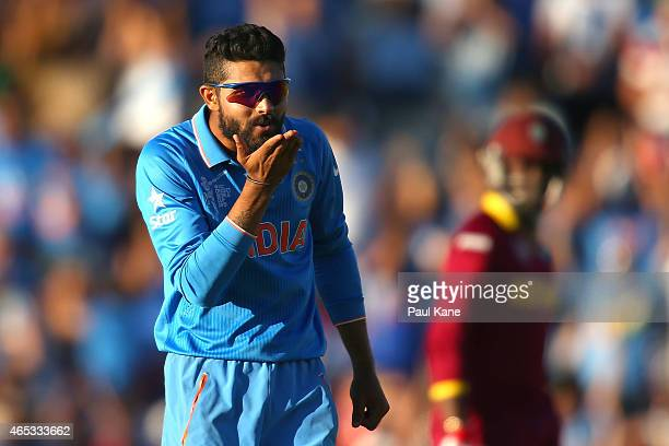 Ravindra Jadeja of India blows a kiss after dismissing Jason Holder of the West Indies during the 2015 ICC Cricket World Cup match between India and...