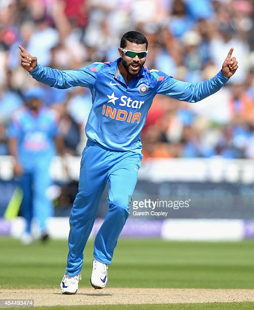 Ravindra Jadeja of India celebrates dismissing Eoin Morgan of England during the 4th Royal London One Day International match between England and...