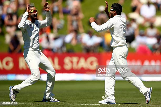 Ravindra Jadeja of India celebrates his wicket of Corey Anderson of New Zealand with Shikhar Dhawan during day three of the 2nd Test match between...