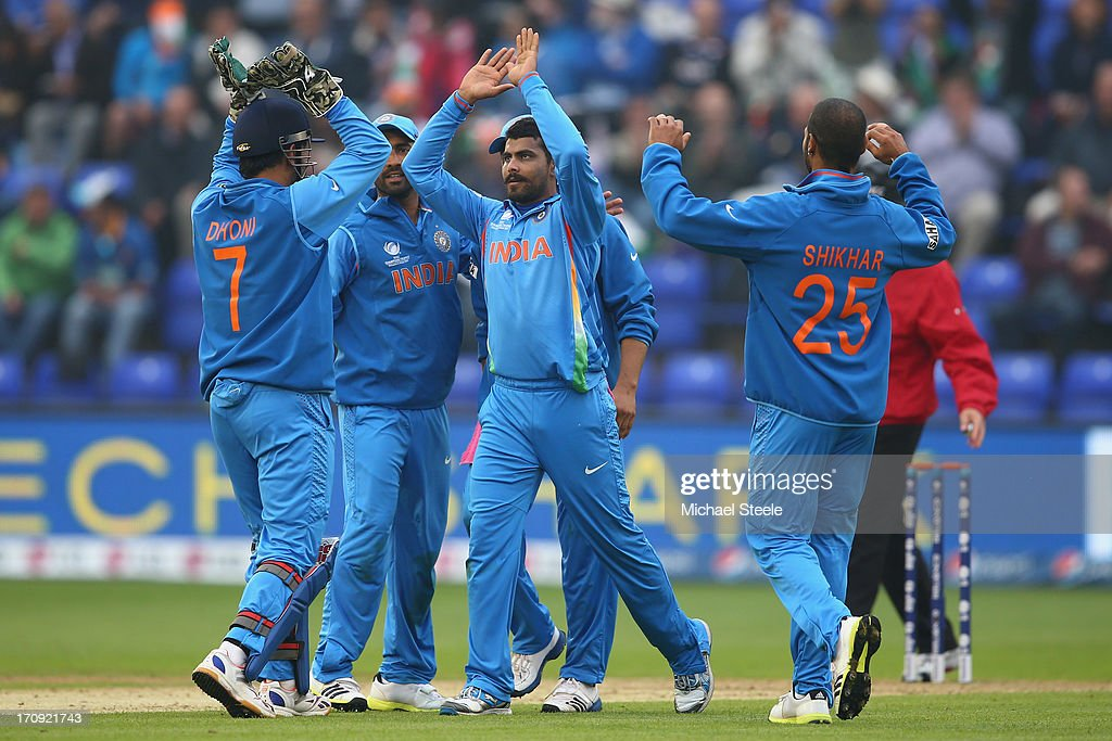 <a gi-track='captionPersonalityLinkClicked' href=/galleries/search?phrase=Ravindra+Jadeja&family=editorial&specificpeople=4880243 ng-click='$event.stopPropagation()'>Ravindra Jadeja</a> (C) of India celebrates with his captain MS Dhoni (L) after taking the wicket of Mahela Jayawardena of Sri Lanka during the ICC Champions Trophy Semi-Final match between India and Sri Lanka at the SWALEC Stadium on June 20, 2013 in Cardiff, Wales.
