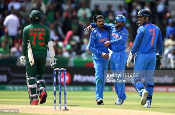 Ravindra Jadeja of India celebrates with Kedar Jadhav after dismissing Shakib Al Hasan of Bangladesh during the ICC Champions Trophy Semi Final...