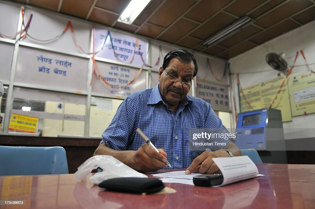 Ravindra kumar posts his last telegram as a souvenir, as his grandfather worked as a TAARBABU at General Post Office on July 14, 2013 in Jaipur, India. The work to lay telegraph lines started in 1850 on an experimental basis between Koklata and Diamond Harbour, it was opened for use by the British East India Company the following year. In 1854, the service was made available to the public. 163-year-old telegram service is being shut down by the Government from 15th of July, across the country.