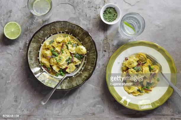 Ravioli with green peas and pancetta
