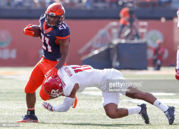 Ra'Von Bonner of the Illinois Fighting Illini runs the ball as Isaiah Wharton of the Rutgers Scarlet Knights makes the tackle at Memorial Stadium on...