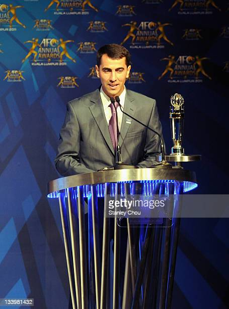 Ravshan Irmatov of Uzbekistan delivers his speech after he was awarded The 2011 AFC Referee of the Year during the 2011 AFC Annual Awards at The...