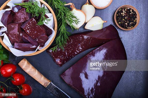 Raw beef liver over gray background viewed from above