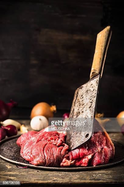 raw beef meat and flying cleaver