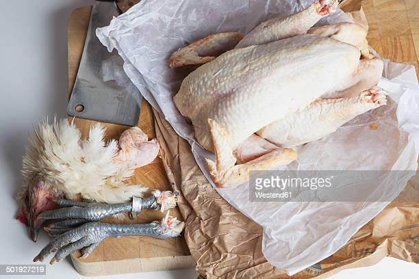 Raw Bresse chicken on chopping board