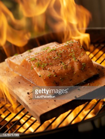 Raw Cedar Plank Salmon Fillet on an outdoor BBQ