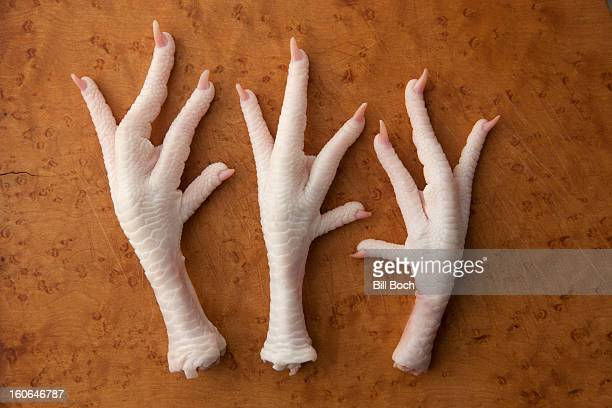 Raw chicken feet on a cutting board