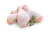 Raw chicken legs on white background isolated