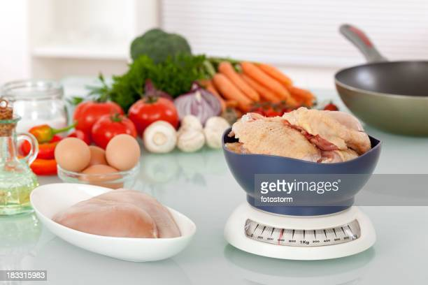 Raw chicken meat and vegetables