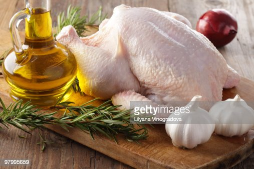 Raw Chicken With Rosemary Garlic And Olive Oil Stock Photo | Getty ...