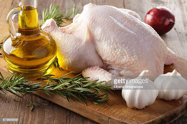 Raw chicken with rosemary, garlic, and olive oil