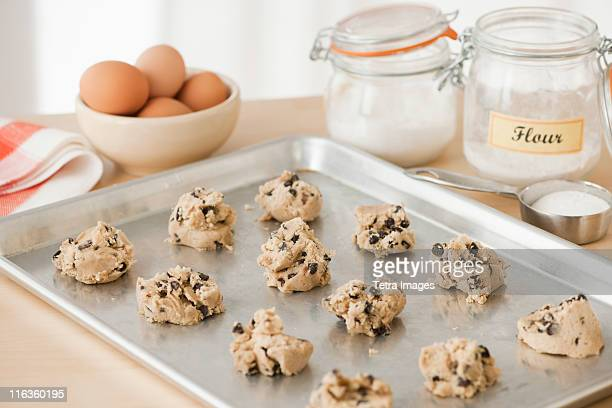 Raw cookies on baking tray